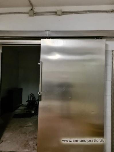 PORTA SCORREVOLE IN ACCIAIO INOX